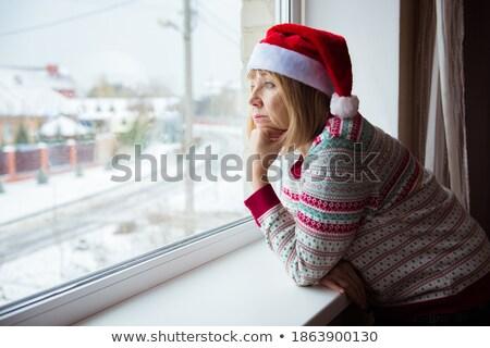 Lonely thoughtful mature woman behind window Stock photo © roboriginal