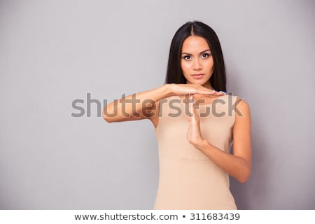 beautiful woman showing time out sign stock photo © deandrobot