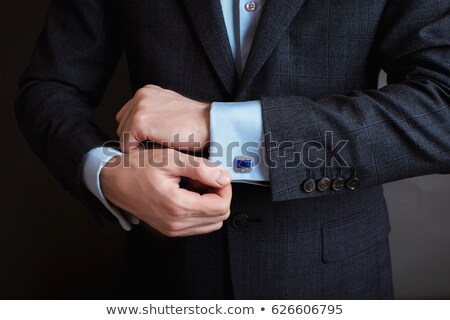 Gentleman in Black Tie Straightens His Bowtie Stock photo © jackethead