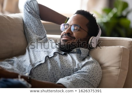 Man with Headphones Listening to Music Meditating Stock photo © kentoh