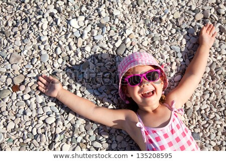 child lies on pebble beach Stock photo © Paha_L