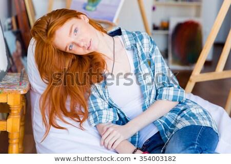 vrouw · ontspannen · schommelstoel · portret · mooie - stockfoto © deandrobot