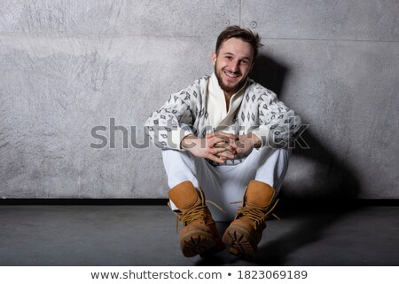 bearded casual man in jeans posing seated stock photo © feedough