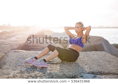 girl does exercises on the beach Stock photo © adrenalina
