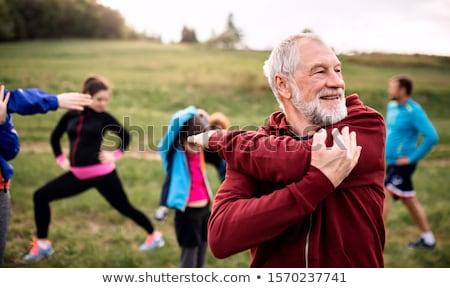 Fitnessz férfi nő áll kívül természet Stock fotó © NicoletaIonescu