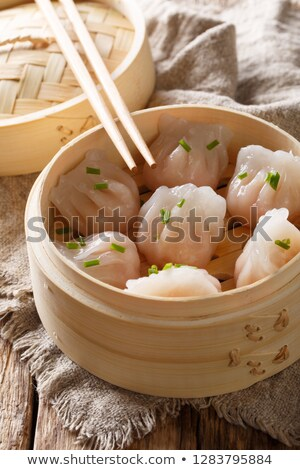 Freshly cooked dumplings inside of bamboo steamer ready to eat  Stock photo © tab62