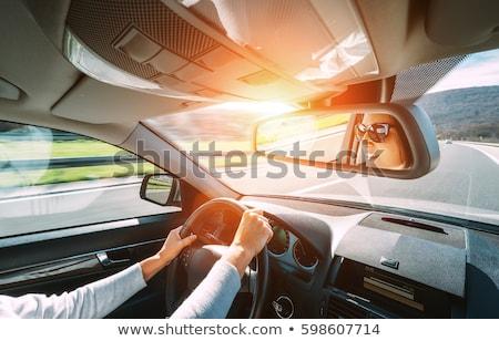 woman driving a car   female driver at a wheel of a modern car stock photo © lightpoet