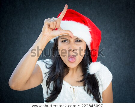 disappointed woman with christmas santa claus hat stock photo © stevanovicigor
