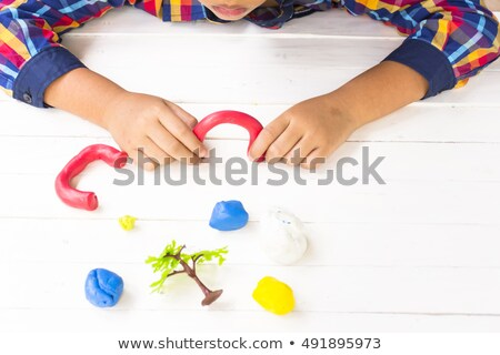 Child with Clay and using creativity for making red door of garden and etc.Top view and Zoom in. Stock photo © Bigbubblebee99
