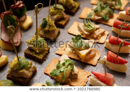 Preparing a catering buffet style with different light snacks an Stock photo © Oakozhan