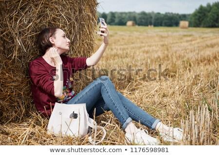 Stock photo: Young beautiful playful women near hay stacks