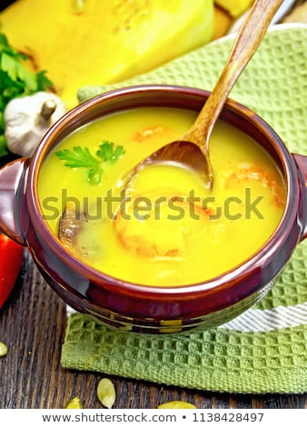 Soup-puree pumpkin with shrimps in a clay bowl with parsley stock photo © FOTOART-MD