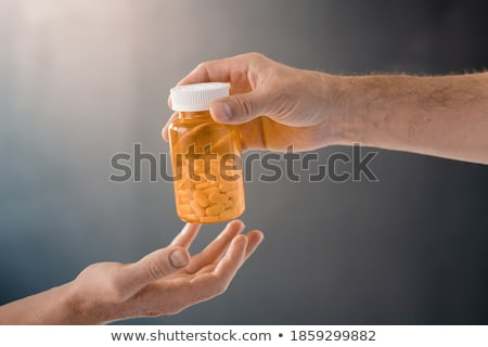 Woman passed out from taking pain medicine  Stock photo © tab62