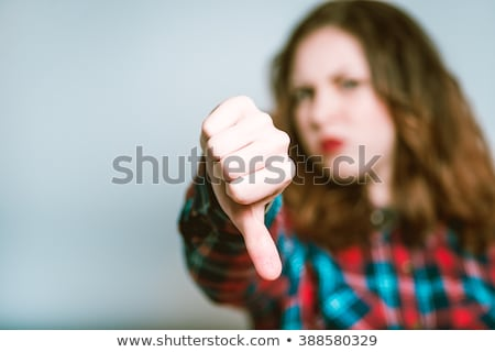 Disappointed business woman with thumb down. Stock photo © RAStudio