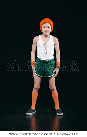 Smiling sporty boy with eyeglasses exercising isolated on black Stock photo © LightFieldStudios