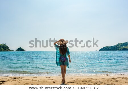 rear view of woman standing on sand against clear sky stock photo © wavebreak_media