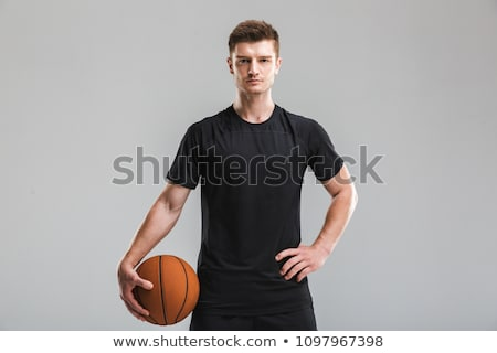 Concentrated young sportsman standing isolated Stock photo © deandrobot