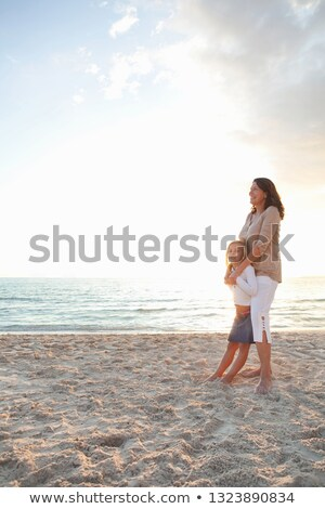 Family hugging at the beach Stock photo © IS2
