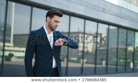 stylish businessman with wristwatch stock photo © LightFieldStudios