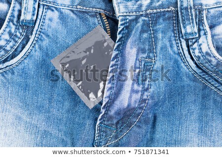 Silver Color Condom In The Pocket Of A Blue Jeans Stock photo © AndreyPopov