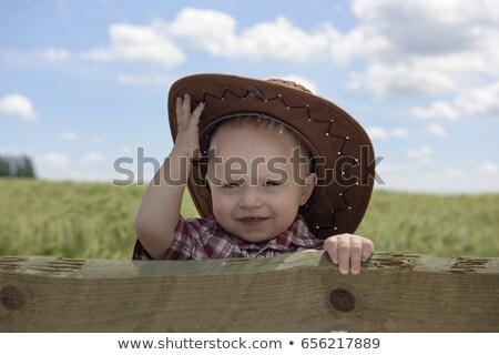Jongen cowboyhoed glimlachend leuk energie geluk Stockfoto © IS2