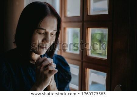 close up of sad woman praying god in church Stock photo © dolgachov