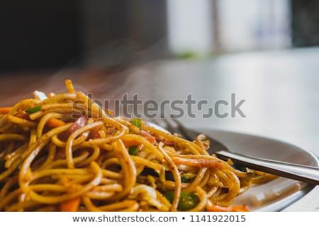 vrouw · eten · kom · chinese · eetstokjes - stockfoto © fisher