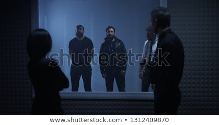 Group of policemen detain criminal Stock photo © jossdiim
