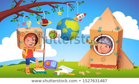 Boy playing with cardboard spaceship Stock photo © IS2