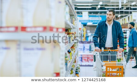 Man looking at goods in grocery section while shopping in supermarket Stock photo © wavebreak_media