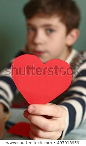 Garçon papier coeur regarder fille Photo stock © IS2