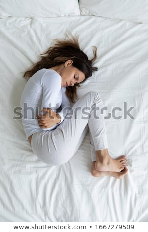 Caucasian sad girl having stomach ache. Stock photo © RAStudio