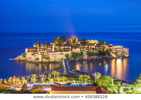Old town and seashore with beach in Budva in Montenegro Stock photo © bezikus