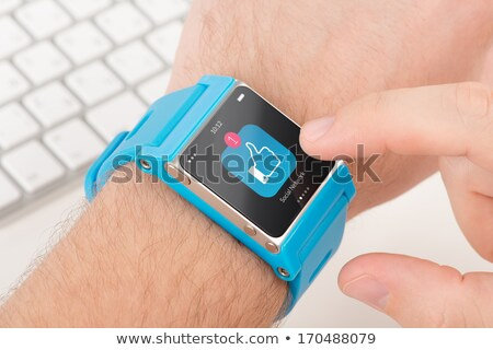 close up of smart watch with social media icons Stock photo © dolgachov