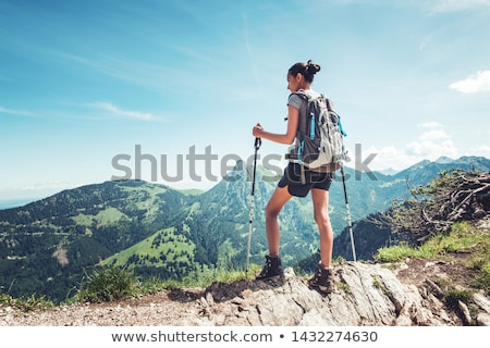 woman with backpack over alps mountains Stock photo © dolgachov