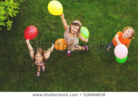 Three happy kids with colorful balloons Stock photo © colematt