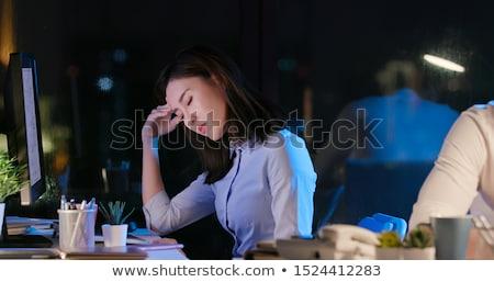 biznesmen · ból · szyi · posiedzenia · biurko · laptop · biuro - zdjęcia stock © dolgachov