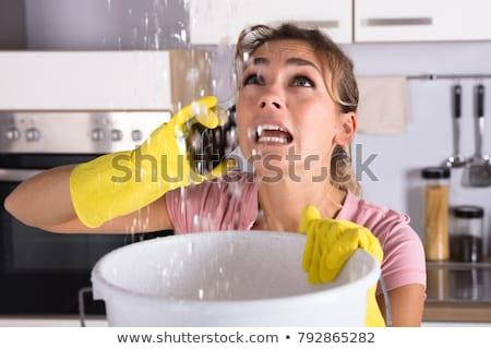 Vrouw verzamelen water plafond emmer ongelukkig Stockfoto © AndreyPopov