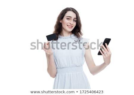 Elképesztő fiatal nő pózol izolált kék fal Stock fotó © deandrobot