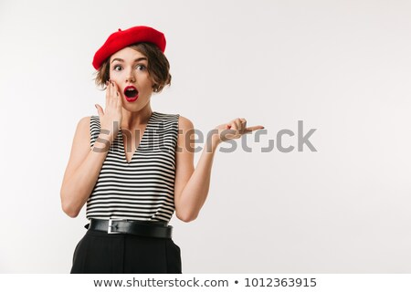 Portrait of a shocked young woman wearing beret Stock photo © deandrobot