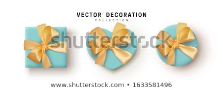 set white heart shape gift box with bow and ribbon top view element for decoration gifts greetings stock photo © olehsvetiukha