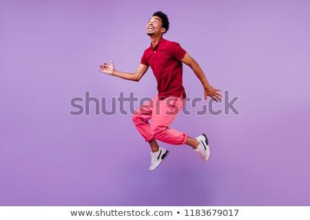 Happy man jumping for joy Stock photo © jossdiim