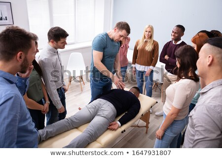 Man Giving Teaching Massage To Group Of People Stock photo © AndreyPopov