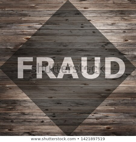 Fraud text on seasoned wood background. Stock photo © szefei