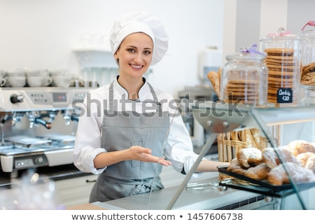 Confectioner woman in her shop selling cookies and cakes Stock photo © Kzenon