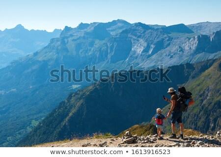 Little Girl Taking Photo Of Mountain Landscape Stock photo © AndreyPopov