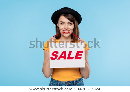 Pretty young woman in hat announcing seasonal sale Stock photo © pressmaster