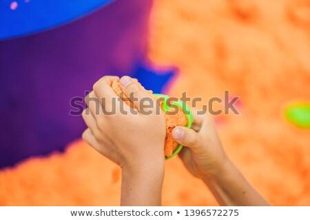 Fiúk kezek játszik narancs homok kéz Stock fotó © galitskaya