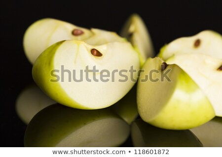 close up of apple slices on black background stock photo © lichtmeister