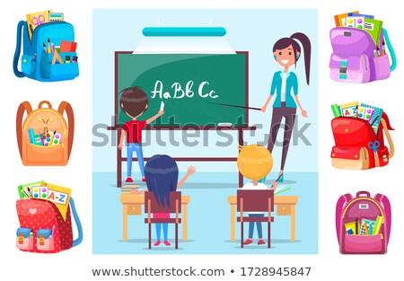 teacher with pointer near chalkboard with alphabet stock photo © robuart
